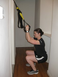 Kate Vidulich NYC Personal Trainer TRX squat