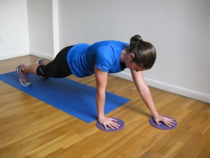 NYC Personal Trainer plank with gliders alternating arm slide away